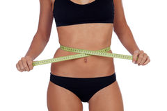 Girl in black underwear with a tape measure around her waist Royalty Free Stock Photos