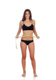 Girl in black underwear with tape measure Royalty Free Stock Photography