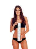 Girl in black underwear with a thermometer Stock Photo