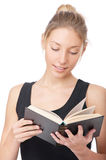 Girl in black vest reads book Stock Photo