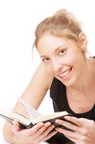 Girl in black vest reads book Royalty Free Stock Images