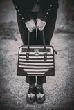 Girl with black and white bag in the hands Royalty Free Stock Images