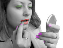 Girl (black-white) and cosmetics (coloured). Isolated Royalty Free Stock Images