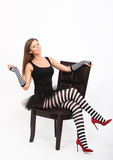 Girl in black and white striped tights Stock Photos