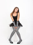 Girl in black and white striped tights Royalty Free Stock Photos