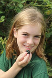 Girl with a blackberry. Pretty girl holding a blackberry and smiling Royalty Free Stock Photography