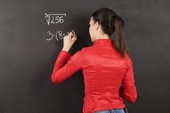 Girl at blackboard Stock Images