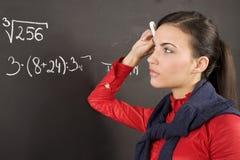 Girl at blackboard Stock Image
