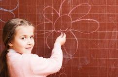 Girl at blackboard Stock Photography