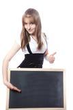 Girl about a blackboard Stock Photos