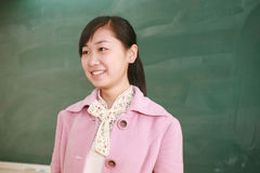 Girl before blackboard Stock Images