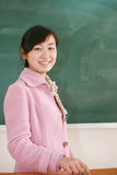 Girl before blackboard Stock Photo