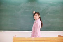 Girl before blackboard Stock Images