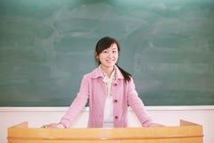 Girl before blackboard Royalty Free Stock Images