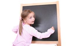 Girl and the blackboard. Girl and blackboard on the white background Royalty Free Stock Image