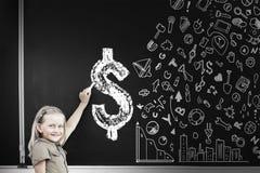 Girl at blackboard. Cute school girl drawing dollar sign on blackboard Stock Image