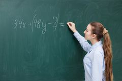 girl at the blackboard in a mathematics class Royalty Free Stock Image