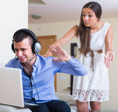 Girl blaming boyfriend in visiting date sites Royalty Free Stock Photography