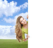 Girl with a blank banner. Perfect space to put any text. Stock Photography
