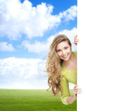 Girl with a blank banner. Perfect space to put any text. Stock Images