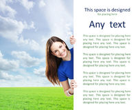 Girl with the blank banner. Perfect space to put any text. Royalty Free Stock Image