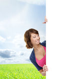 Girl with the blank banner. Perfect space to put any text. Stock Photography