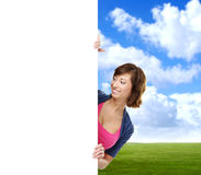 Girl with the blank banner. Perfect space to put any text. Royalty Free Stock Images
