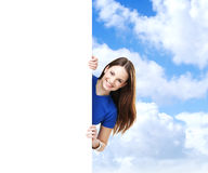 Girl with the blank banner. Perfect space to put any text. Stock Images