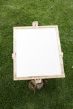 Girl and Blank Canvas Stock Image