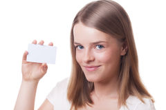 Girl with blank card. Attractive smiling girl with blank card on isolated white Royalty Free Stock Images