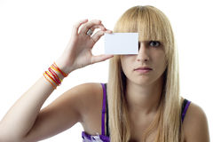 Girl with a Blank Card on Her Eye Stock Image