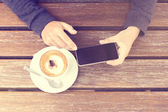 Girl with blank cell phone and cup of coffee Royalty Free Stock Photos