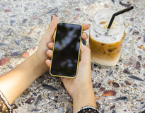 Girl with blank cell phone and fresh juice Stock Images