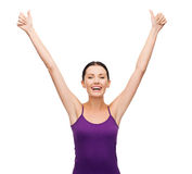 Girl in blank purple tank top with crossed arms Stock Photography