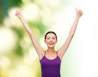 Girl in blank purple tank top with crossed arms Royalty Free Stock Photo