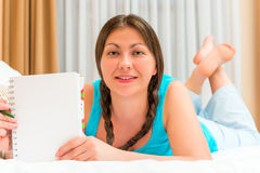 Girl and blank sheet of notebook for writing Stock Images