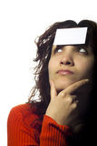 Girl with a Blank Ticket on Her Forehead Royalty Free Stock Images