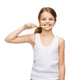 Girl in blank white shirt brushing her teeth Royalty Free Stock Images