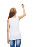 Girl in blank white shirt drawing something Stock Image