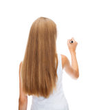Girl in blank white shirt drawing something. Education, new technology and advertisement concept - teenage girl in white shirt from the back drawing or writing Royalty Free Stock Photos