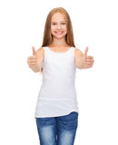 Girl in blank white shirt showing thumbs up Royalty Free Stock Photography