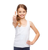 Girl in blank white shirt showing thumbs up Royalty Free Stock Photo
