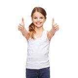 Girl in blank white shirt showing thumbs up Stock Photos