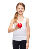 Girl in blank white shirt with small red heart Royalty Free Stock Photography