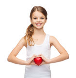 Girl in blank white shirt with small red heart Royalty Free Stock Photo