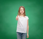 Girl in blank white t-shirt showing thumbs up Royalty Free Stock Images