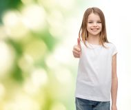 Girl in blank white t-shirt showing thumbs up Stock Photography