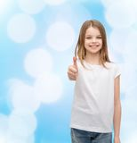 Girl in blank white t-shirt showing thumbs up Stock Image