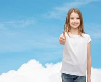 Girl in blank white t-shirt showing thumbs up Royalty Free Stock Photos