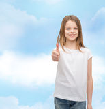 Girl in blank white t-shirt showing thumbs up Stock Photos